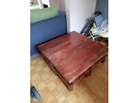 Wooden Coffee table with 4 pull-out cushioned stools