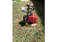 Petrol strimmer,. Long straight shaft. Easy to start. Heavy duty. (North Dorset)