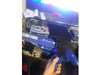 Ps4 in box with controller games and turtle beach headset