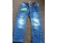 Boys next jeans with dinosaurs age 2-3
