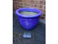 Large blue glazed plant pot with feet