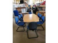 Used boardroom conference table in beech and 8 used blue chairs.