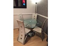 Glass round table with lazy susan middle section and 4 chairs