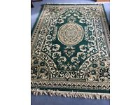 Rug - unused short pile green rug 165 x 231cm