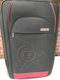 Dunlop Medium size 2 wheeled expander suitcase. Red & Black