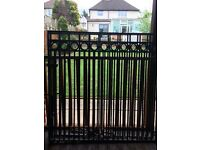 Pair of wrought iron gates with posts