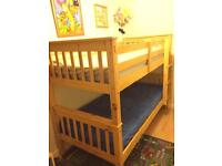 Set of wooden single bunk beds