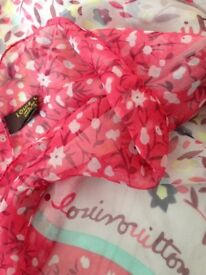 A used Louis Vuitton scarf in excellent condition