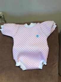 Swimsuit (baby snug) never been used.
