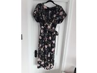 Three quarter length jump suit. New Look. Size 14.