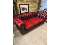 Retro oxblood leather Chesterfield 3 seater sofa. New base cover and ball casters. 6x3 ft.