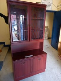 small reddish coloured wood wall unit
