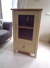 Glass fronted shelf unit with drawer