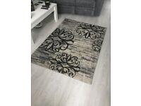 Black and grey patterned rug,