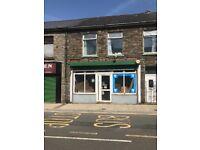 Town Centre Shop - Infront of Bus Stop