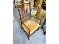 Child's wicker wooden high-backed chair. Antique. Vintage.