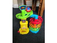 Kids toy car park with swirly slide and car