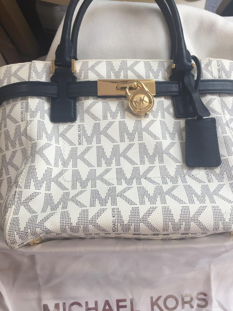 57e47cb76fca Michael Kors Hamilton bag in white with navy MK monogram.