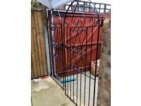 Pair of decorative garden driveway metal gates.