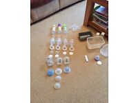 Selection of bottles, breastpump and accessories