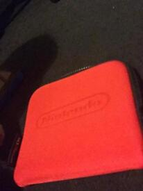 Ds case and 2 games