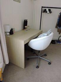 White ovoid desk chair on castors