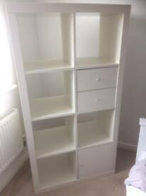 White cube storage unit with drawers and door
