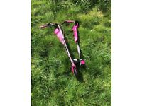 Pink and black scissor scooter
