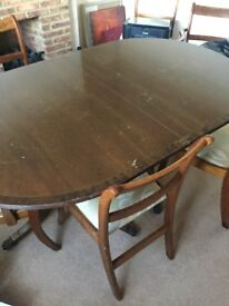 Brown wood dining table and 6 chairs
