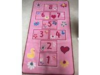 Children's pink hopscotch rug