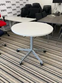 White Steelcase table on wheels