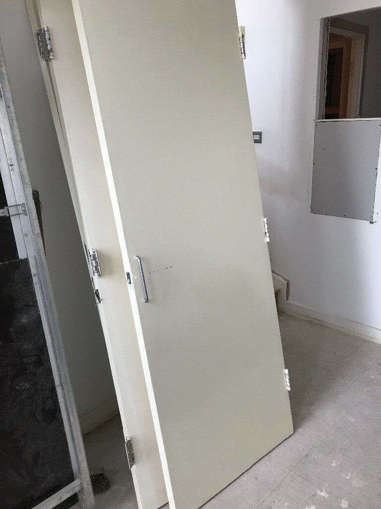 Fire doors with hinges and handles