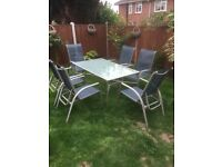 Garden table and six reclining chairs for sale