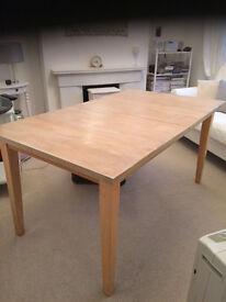 Light oak dining table.