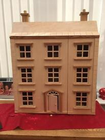 Wooden dolls house and lots of accessories in very good condition