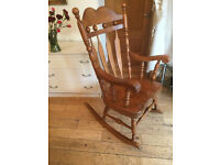 A SUPERB LARGECROWN TOPPED ROCKING CHAIR WITH 2INCH THICK SHAPED SEAT