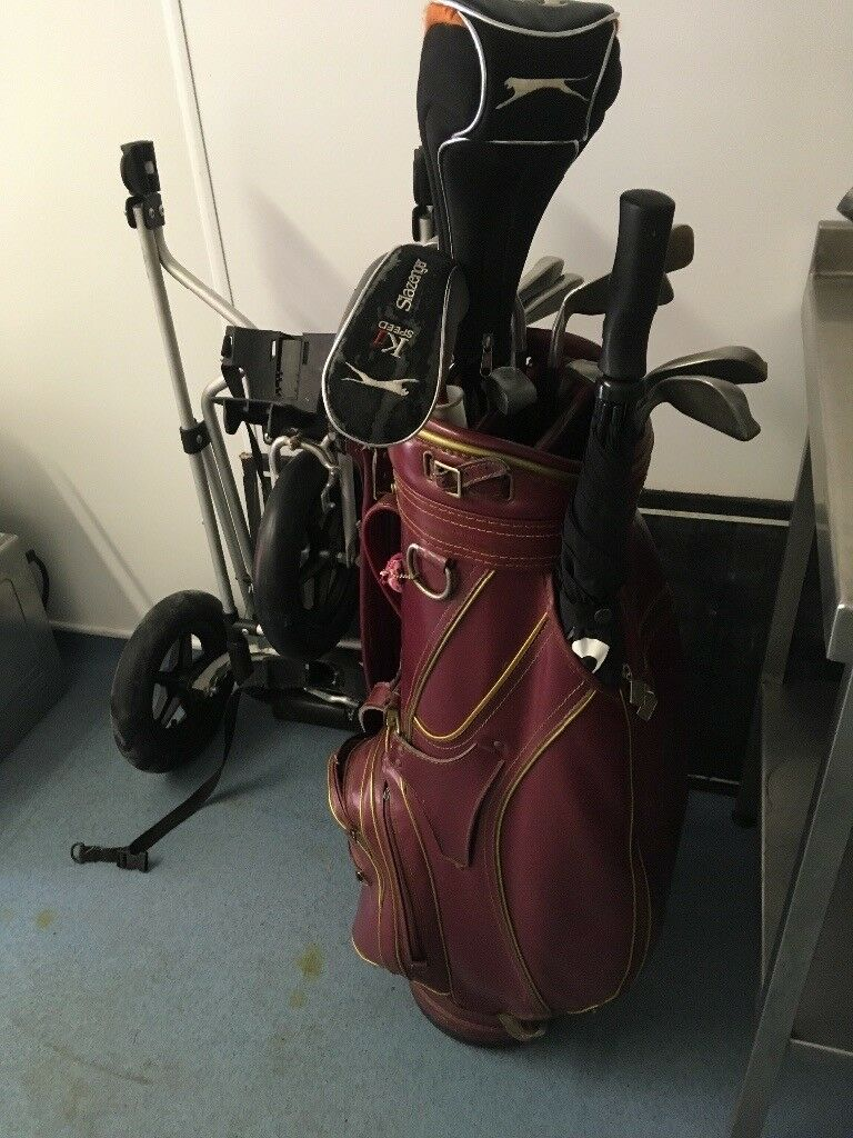 Set of used golf clubs with bag and trolly