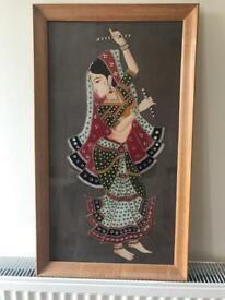 Indian dancer in frame. bejewelled image on cloth