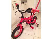 "Lightning McQueen boy's 12 inch bike, girl's ""Bunny Pedal Pets"" 12 inch bike."
