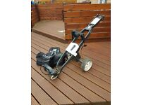 GoKart electric golf trolley with push handle controls and travel bag.