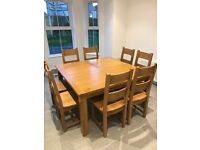 Large oak table and 8 chairs