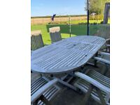 Solid teal oval table and 6 folding teak arm chairs