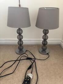 Two grey table lamps