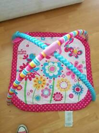 Baby gym mat with toys.