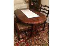 Oak table extendable with 4 chairs