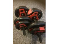 20 kg dumbbells with option for extra weight.