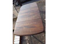 Dark wood fold up table