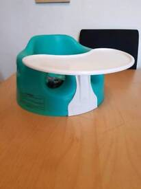 Turquoise Bumbo seat with play tray and straps