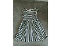 Brand new without tags. NEXT girls dress age 6