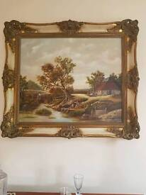 Ornate framed countryside painting